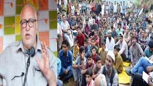 Minister for PWD, Abdul Majid Wani addressing a public gathering on Monday.