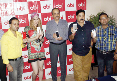 CEO Obi Mobiles and others displaying smartphones of the company during a news conference at Jammu on Friday. -Excelsior/Raeksh