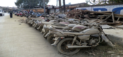 Long queues of motorcycles outside a workshop in the flood hit area in Srinagar on Tuesday, where thousands of vehicles got damaged after remaining under water for about one to three weeks. (UNI)