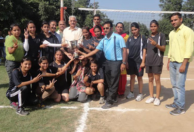 Winner team of Inter-Collegiate Volleyball Championship posing with trophy at Sports Stadium, JU, Jammu.