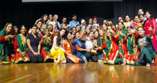 Students of GCW, Gandhi Nagar showing victory sign after clinching overall trophy of 'Display Your Talent' at General Zorawar Singh Auditorium, University of Jammu on Wednesday.