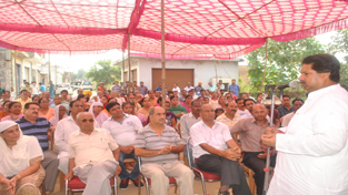 Minister for Housing, Raman Bhalla interacting with people at Shastri Nagar on Sunday.