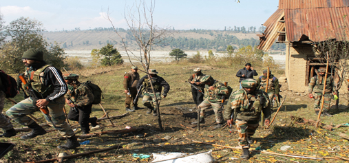 Army soldiers patrol after recovery of an IED in Shopian on Friday. — Excelsior/Younis Khaliq