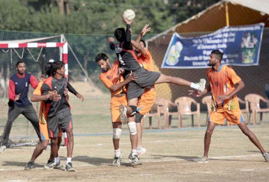 Player making a valiant attempt to shoot a goal during Inter-University Handball match on Monday. -Excelsior/ Rakesh