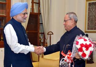 President Pranab Mukherjee being presented a bouquet by former Prime Minister Manmohan Singh on his birthday at Rashtrapati Bhavan in New Delhi on Thursday. (UNI)