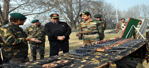 Defence Minister Manohar Parrikar along with Chief of Army Staff Gen Dalbir Singh inspecting the arms and ammunition recovered recently by the Army from slain militants at Uri at the headquarters of Chinar Corps on Thursday.(UNI)