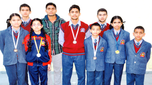 Students of Crescent Public School, Janipur, Jammu, who blossomed in the recently held Sanda Cup Wushu Championship. Fiza Khan bagged gold, Radhika Dutta claimed silver and the bronze medal went to Kartik Basan, Meenakshi Basan and Fiaaz Choudhary.