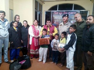 Orphans being presented with gifts after musical night at Katra on Sunday.