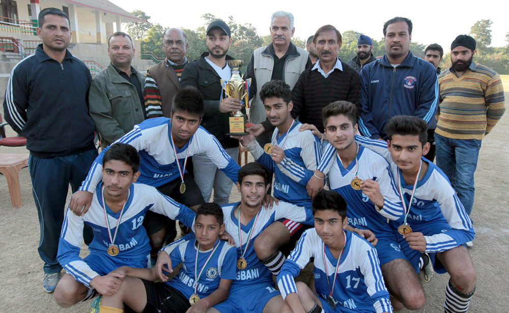 Winners of Mini Football Championship posing along with the chief guest and other dignitaries in Jammu on Saturday. -Excelsior/Rakesh