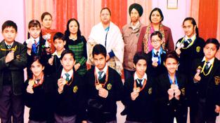 Medal winners in Skating Championship posing along with Principal at DPS Jammu.