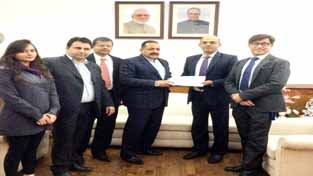 "Union Minister Dr Jitendra Singh being presented a detailed project report by ""Love Care Foundation"" representatives for developing flood-hit Saddal-Panjar as ""smart"" village."