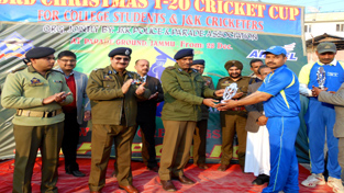IGP Jammu Rajesh Kumar and DIG Jammu Shakeel Ahmed Beig presenting trophy to JKP player Shamsher Singh Manhas during valedictory function of Christmas T20 Cup.