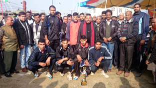 Winning team of Volleyball Tournament posing for group photograph with MLA Samba, Chander Prakash Ganga and others.