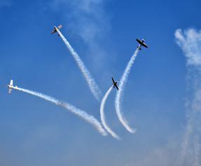 Russian aerobatic team performing during the inaugural ceremony at Yelahanka air base near Bengaluru on Wednesday. (UNI)