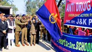 IGP, Rajesh Kumar and DIG, Shakeel Beig flagging off Anti-drug rally at Kathua on Saturday.
