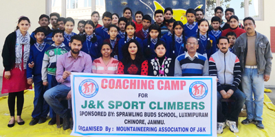 Participants of sport climbing coaching camp posing along with dignitaries at Sprawling Buds School in Jammu on Monday.