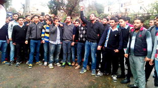 Unemployed Diploma Engineers staging protest outside Raj Bhawan in Jammu on Sunday.