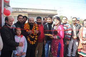 MLA Raipur-Domana, Bali Bhagat, inaugurating outlet of Splash Car Wash at Lower Roop Nagar Jammu on Sunday.