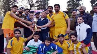 Winners of the Volleyball Tournament being presented trophy in Poonch on Wednesday.