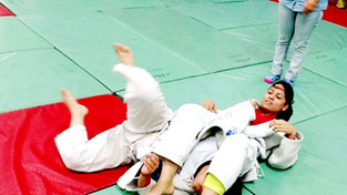 Payers in action during a bout of the 17th State Open Judo Championship at Judo Hall, M A Stadium in Jammu.