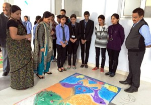 Participants and dignitaries watching beautiful 'rangolies' during Rangoli competition at YCET in Jammu.