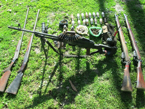 Arms, ammunition and explosives recovered by Army in Kishtwar on Thursday. — Excelsior/Tilak Raj
