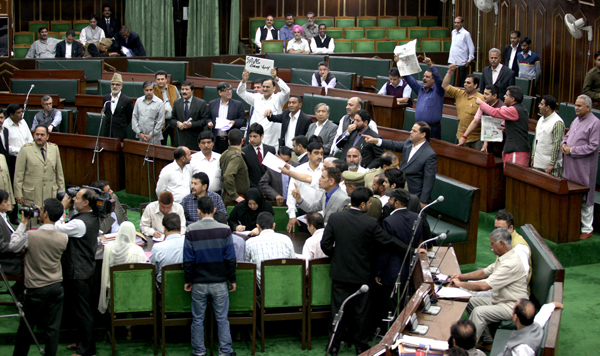 Opposition MLAs protesting in the Assembly seeking relief for flood victims on Monday. — Excelsior/Rakesh
