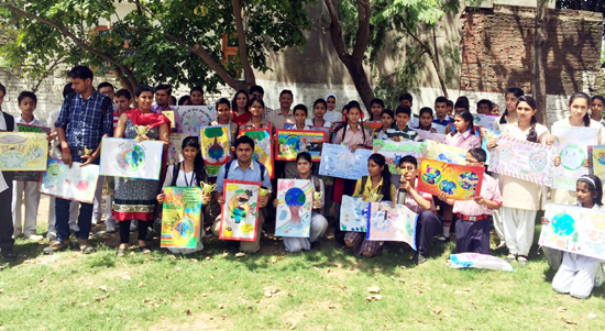 Winners of poster making competition posing for a group photograph