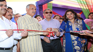 Shamsher Singh Manhas, MP and Dr Anil Kumar, chairman Sanfort group of schools during inauguration of new branch on Monday.