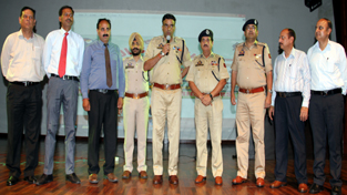 IGP Jammu Danish Rana alongwith other dignitaries declaring PPCPL auction open at Police Auditorium, Gulshan Ground in Jammu on Wednesday.
