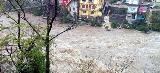 Sewa river flows above danger mark in Bani area of Kathua district on Friday.