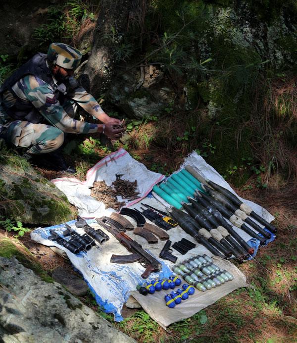 Arms and ammunition recovered at Zandfaran area in Baramulla on Saturday. -Excelsior/Aabid Nabi