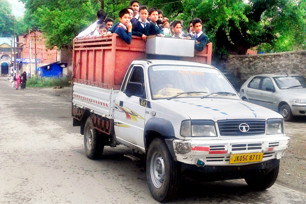 Students travel to school in a load carrier in Baramulla. - Excelsior/Aabid Nabi