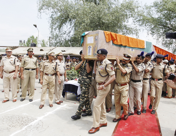 Director General of Police K Rajendra Kumar and senior CRPF officers carry the coffin containing the body of slain CRPF Jawans during a wreath laying ceremony on Tuesday -Excelsior/ Amin War
