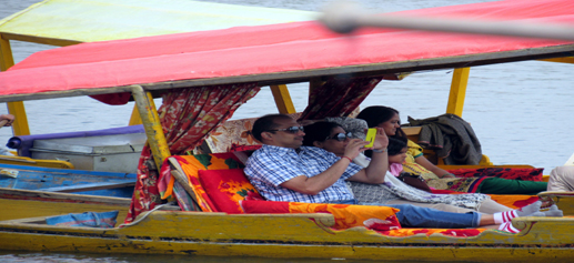 Tourists enjoy shikara ride in Dal Lake at Srinagar on Wednesday. -Excelsior/Amin War