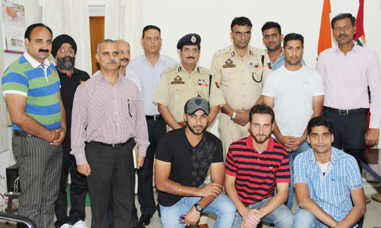 Representatives of sponsors of PPCPL, organizing secretary, joint secretary and the performers of the tournament posing along with IGP Jammu Danesh Rana and DIG Shakeel Beig after receiving cheques against cash prizes on Saturday.