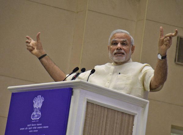 Prime Minister Narendra Modi addressing a gathering in New Delhi on Thursday. (UNI)