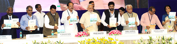 Prime Minister Narendra Modi, Union Urban Development Minister M Venkaiah Naidu and other dignitaries including J&K Deputy Chief Minister Dr Nirmal Singh at the launch of smart cities and AMRUT projects in New Delhi on Thursday.