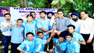 Winners of 2nd Fazil Abbas Rolling Inter-Department Rolling Volleyball Tournament receiving title trophy from Er Arun Bangotra.