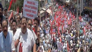 NC provincial president Devender Singh Rana addressing the protesters near Civil Secretariat in Jammu on Tuesday.