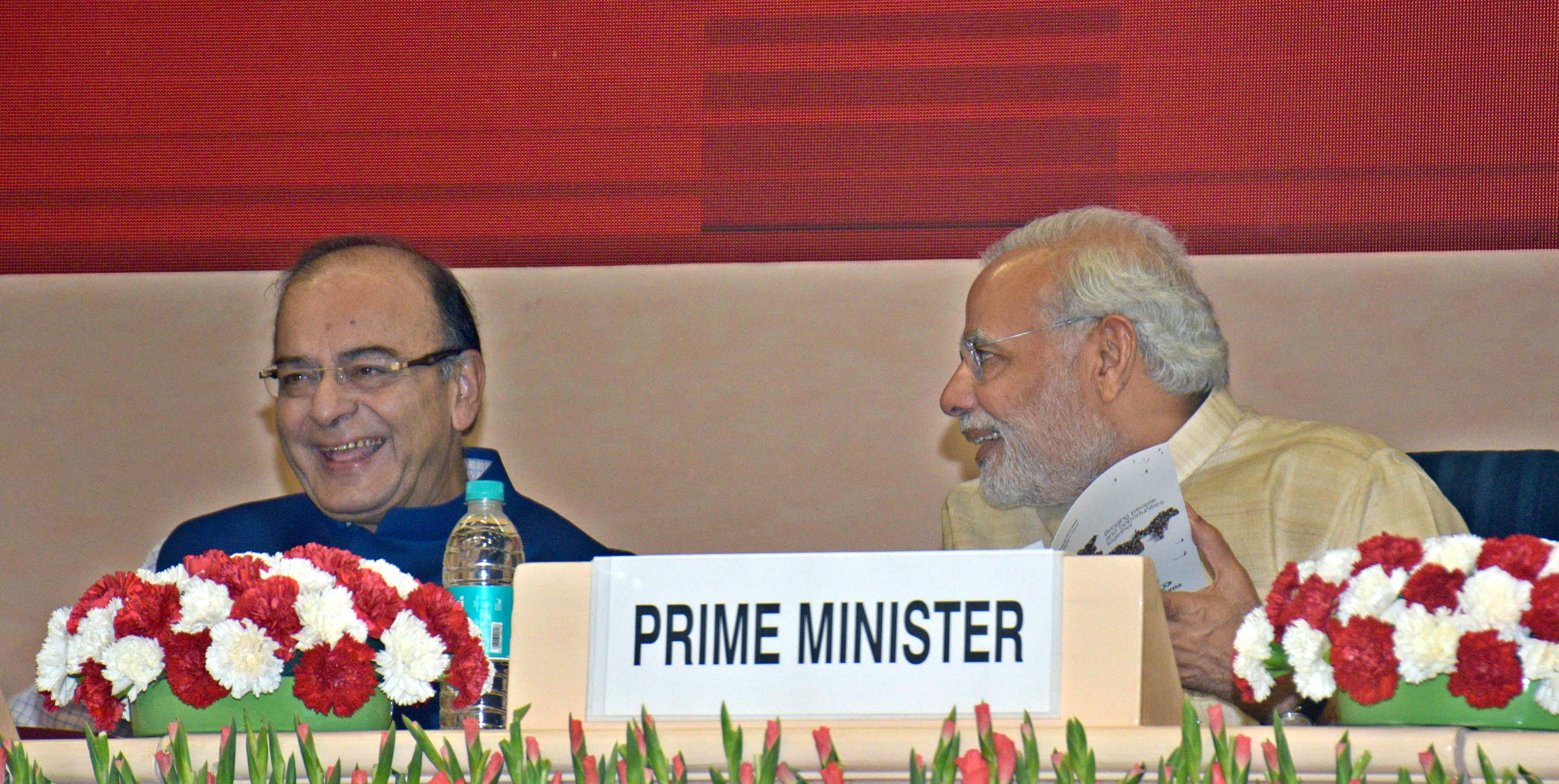 Prime Minister Narendra Modi in conversation with Union Finance Minister Arun Jaitley at the 46th session of Indian Labour Conference in New Delhi on Monday. (UNI)