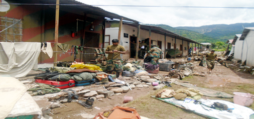 Army jawans collecting their belongings after cloudburst hits Army unit, washing away barracks and bunkers at Chhatral in Mendhar on Firday.