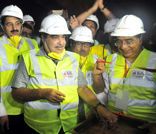 Union Minister Nitin Gadkari triggering final blast at Chenani-Nashri tunnel on Monday. -Excelsior/Vasu Gupta