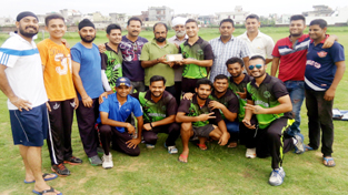 Jubilant RCC Srinagar players posing for a group photograph after defeating Patel Club to top their group in Chevrolet Cricket Cup T20 Tournament at KC School ground in Jammu.
