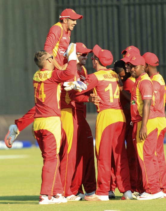 Zimbabwe team celebrating victory against India in 2nd T20 at Harare on Sunday.