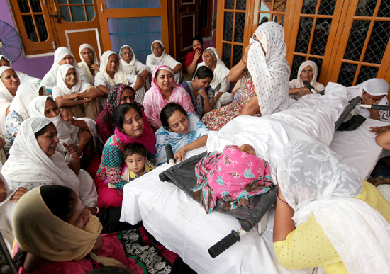 People wail over the body of Banso Devi, who was killed in Pakistan shelling, at Sei Khurd in Arnia sector on Friday. —Excelsior/Rakesh