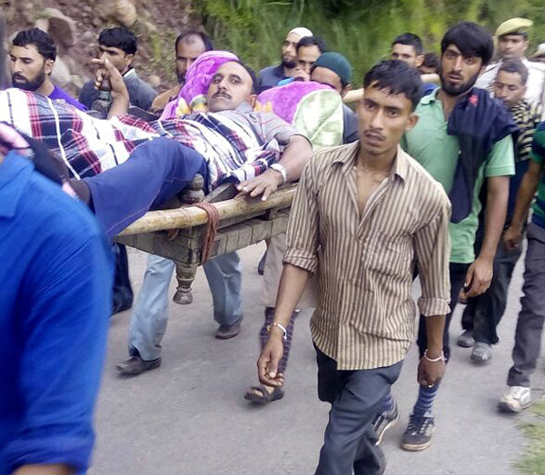 Injured SPO Gul Mohammad being carried in a 'Palki' from Sangh to Basantgarh on Friday morning. — Excelsior/Rakesh