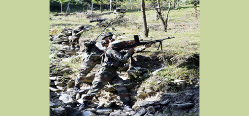 Troops in action during encounter at Qazinag forests of Uri on Wednesday. — Excelsior/Aabid Nabi