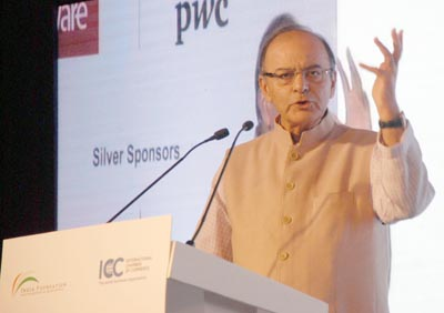 """Finance Minister Arun Jaitley addressing India Economic Convention 2015 on """"Architecture for Growth"""" in New Delhi on Thursday. (UNI)"""