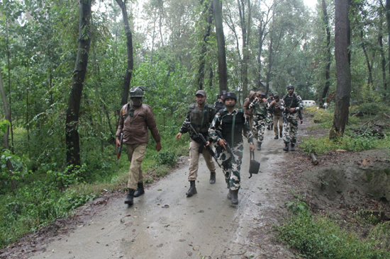 Troops in action during encounter at Awantipora on Tuesday. —Excelsior/Younis Khaliq